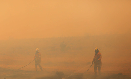 Members of the New South Wales Rural Fire Service extinguishing a fire north of Bredbo, Australia, in February